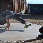 UK BBoy Championships 2011 poster photo shoot - BBoy Sunni holds a baby freeze